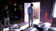 Miguel listens to Dexter describe how Oscar Prado was killed