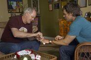 Arthur tends to Dexter's cut finger