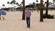 Dexter walks to beach party