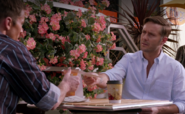 Quinn shows pic of Zach to Saxon