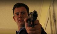 Travis holds gun on Angel