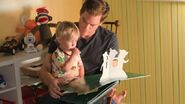 Dexter reads a story to Harrison