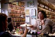 Camilla hands Dexter a file