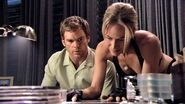 Rita looks at photos of Dexter