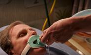 A.J. disengages breathing tube
