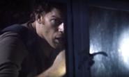 Dexter at morgue window