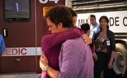 Dr. Ross watches Deb hug Dexter S6E11