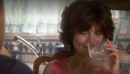 Suzanna takes a drink