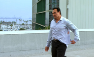 Miguel shows shirt to Dexter S3E10