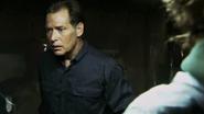 Harry walks in on Dexter dismembering Juan Rinez