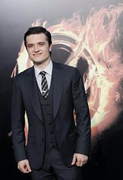 247880-cast-member-josh-hutcherson-poses-at-the-premiere-of-the-hunger-games-.jpg