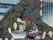 Triceramon smash the car