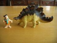 Fred Flintstone e lo stegosauro
