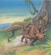 2 Velociraptor che attaccano un Triceratopo