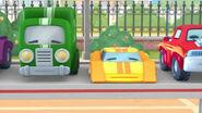 Green truck yellow racecar