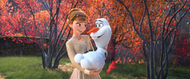 Frozen II - Anna holding Olaf in her Arms.jpg