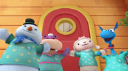Four toy characters in their vet vests