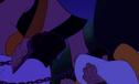 A guard placing shackles on Aladdin's wrists