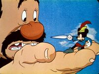 Mickey threatening giant with scissors