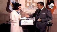 Walt handing julie united duffle bag