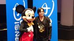 Nomura taking a photo with Mickey Mouse at Walt Disney Studios during the Kingdom Hearts HD II.5 ReMIX launch event