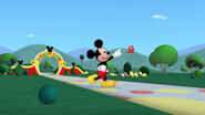 Mickey and baby red bird