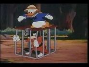Donald has goofy in cage