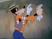 Goofy taking his glove off