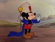 Mickey blowing a whistle