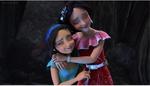 Elena and Isabel hug