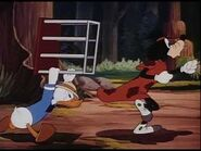 Donald chasing goofy with cage