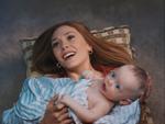 Wanda holding Tommy