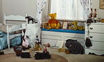 Winnie the Pooh and his friends are stuffed toy animals in Christopher Robin's bedroom