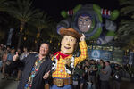 D23-Expo-2015-john-lasseter-Buzz-and-woody