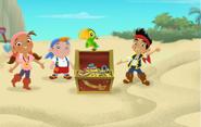 Jake and his crew standing around the Team treasure chest
