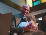 Vision holding Tommy