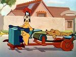 Goofy on pluto-powered car