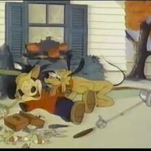 Pluto licking mickey elatedly.jpg