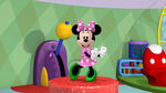Minnie doing the hot dog dance with her green shoes