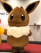 Giant eevee and pikachu costumes at the pokemon company