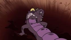 S1E3 Crocodile minion in the dirt.png