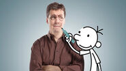 Jeff kinney holding up a gregcutout
