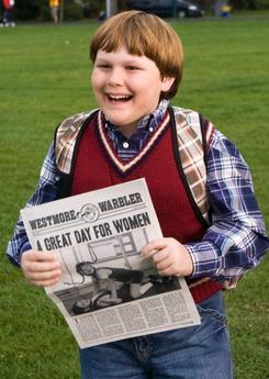 Rowley with school newspaper