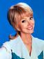 Shelley Long as Carol Brady