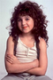 Alisan Porter as Curly Sue