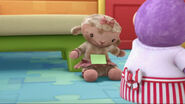 Lambie with a green little paper