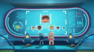 Lambie and robot ray looking at the kids on screen