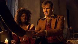 The Next Doctor - Lake viendo el reloj.png