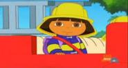 Dora sitting on rojo