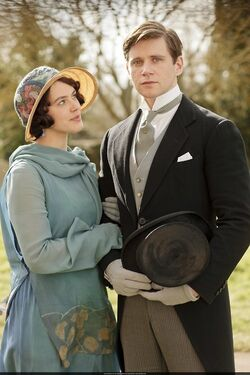 Lady Sybil and Tom at Mary and Matthew's wedding in 1920. Sybil is pregnant at this time.